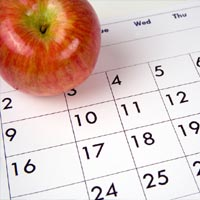 photo of a calendar (with an apple for teacher)